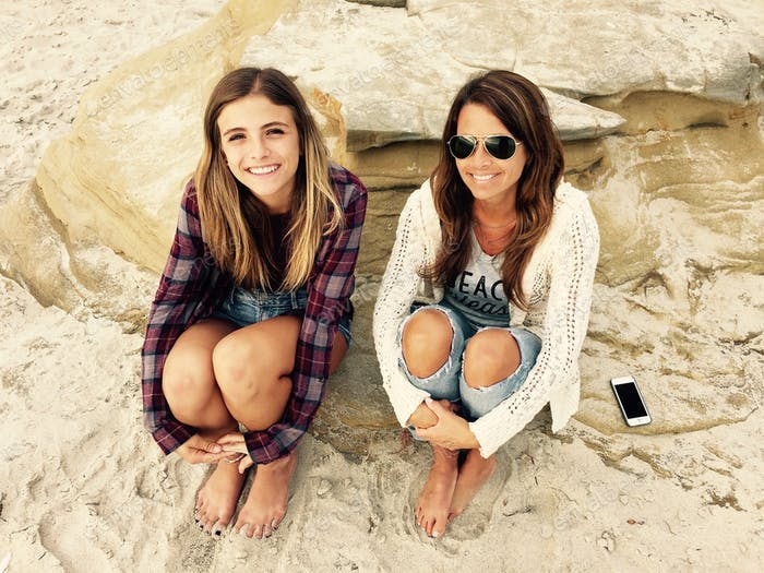 Mother and daughter sitting on the beach in San Diego, California Tonythetigersson Tony Andrews Phot
