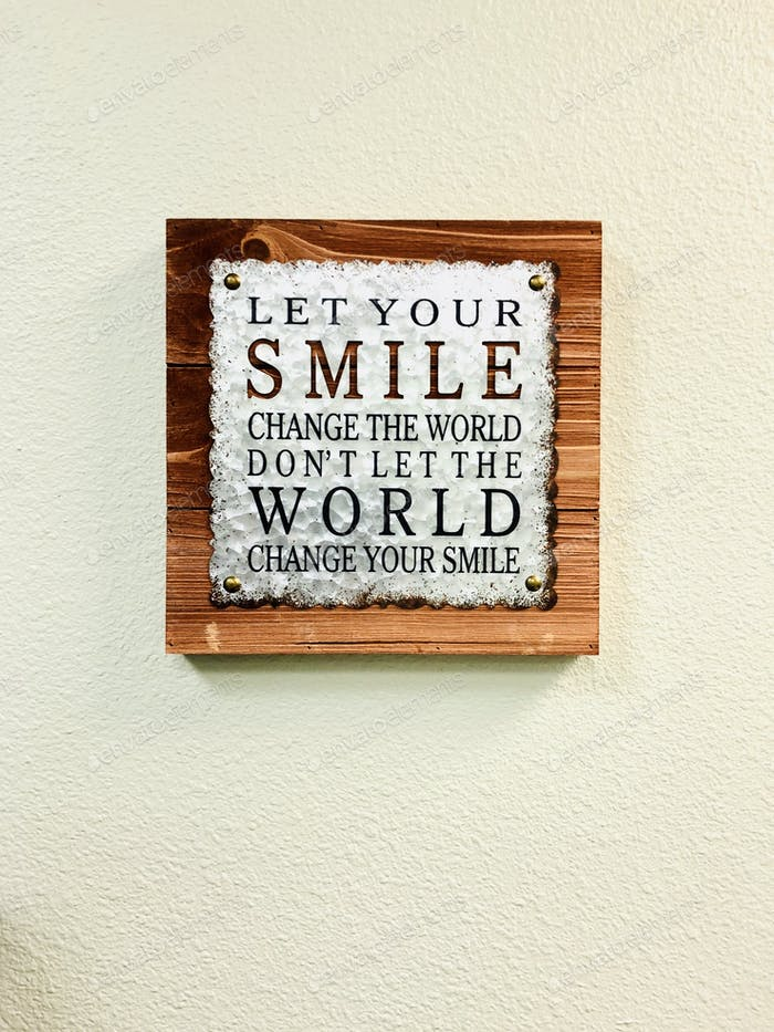 A wall hanging with words of encouragement.