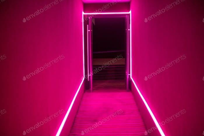 neon colored pathway with open door