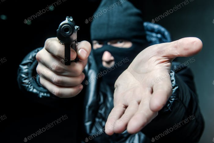 Robber aiming gun