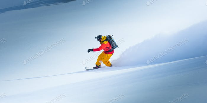 Snowboarder going down the hill