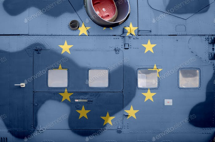 European union flag depicted on side part of military armored helicopter close up