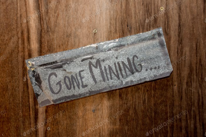 Gone Mining sign on the rustic wooden door.  Bitcoin. Cryptocurrency