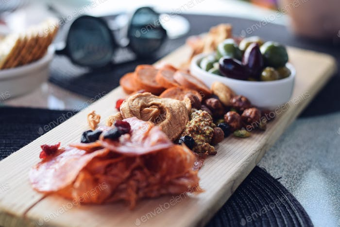Cured meats and dried fruits Charcuterie board at a restaurant