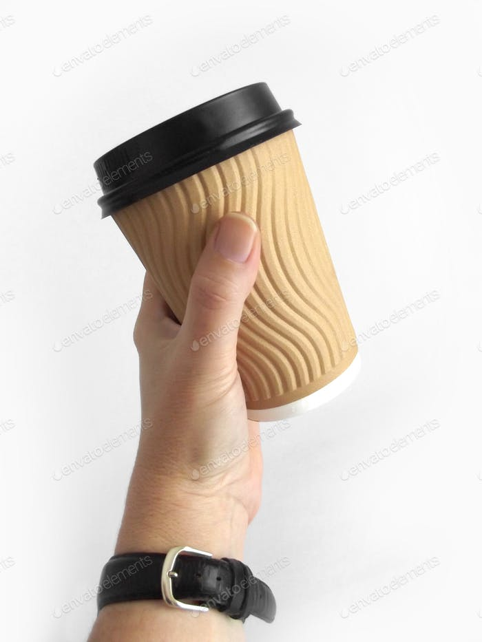 Holding a takeaway coffee cup