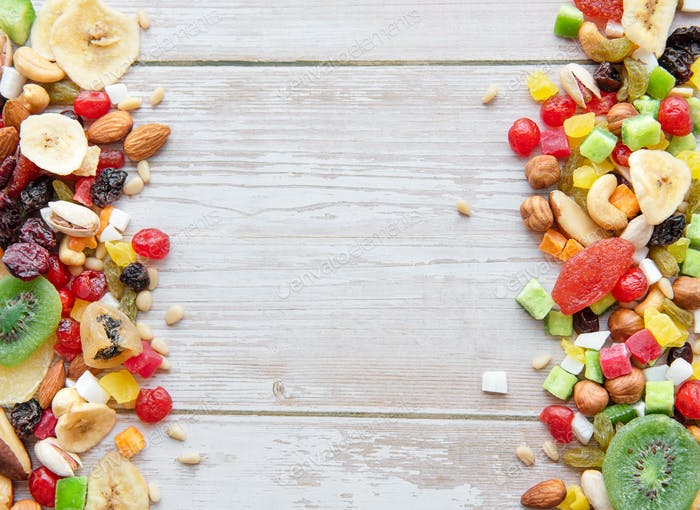 Various dried fruits and nuts on a wooden  background