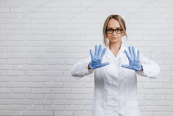 Medical doctor woman in blue medical gloves
