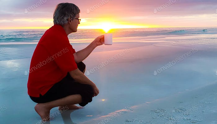 Active babyboomer deep in thought as to how much vitamin D to add to his cup....