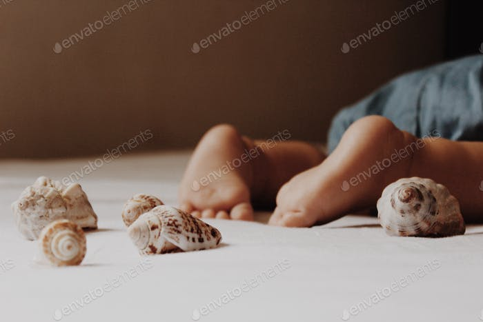seashell nap with sweet baby toes