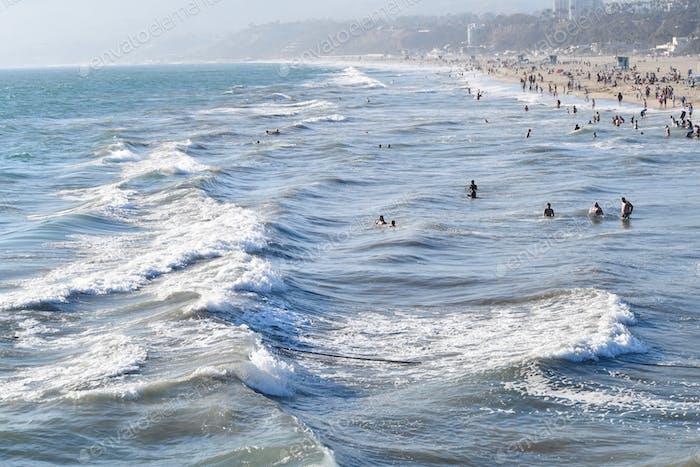 Enjoying the waves at Santa Monica beach at Summer's end