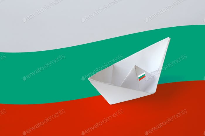 Bulgaria flag depicted on paper origami ship closeup. Oriental handmade arts concept