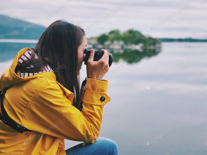 Young photographer on the lake in Ireland