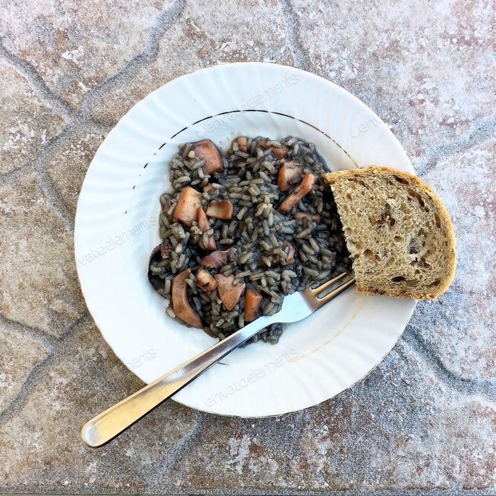 Directly above shot of black rice dish made with squid,traditional Croatian dish served in Dalmatia