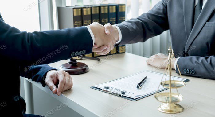 Handshake after Lawyer providing legal consult business dispute service to the man at the office