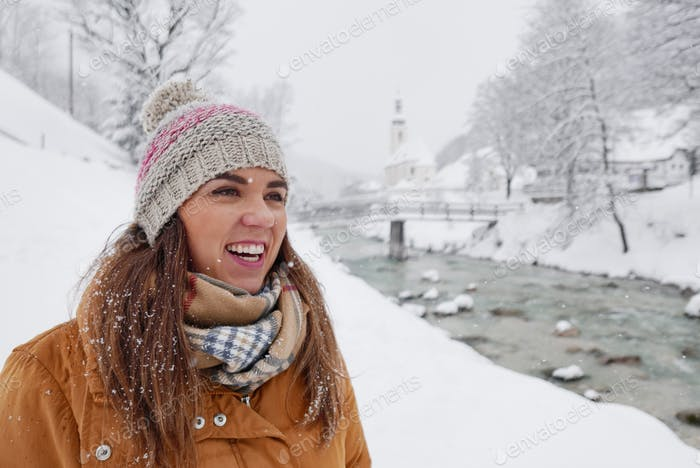 Portrait of a happy young woman in winter, smile, positive emotion.