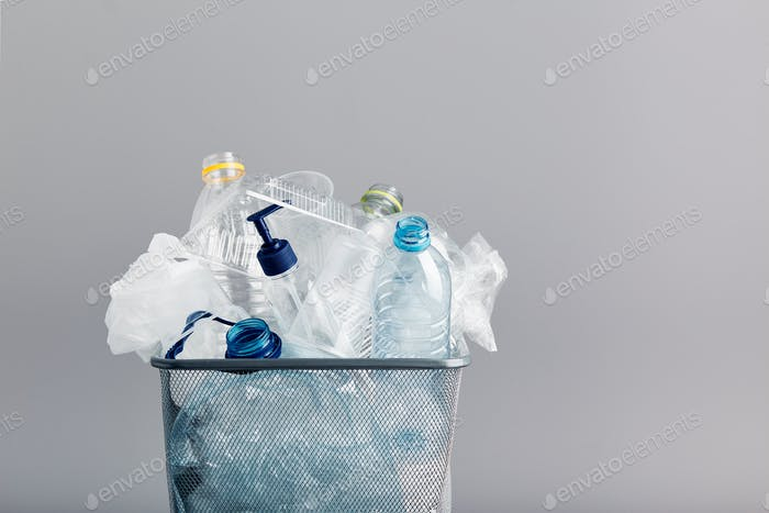 Heap of plastic bottles, cups, bags. Plastic pollution. Plastic waste. Environment damage