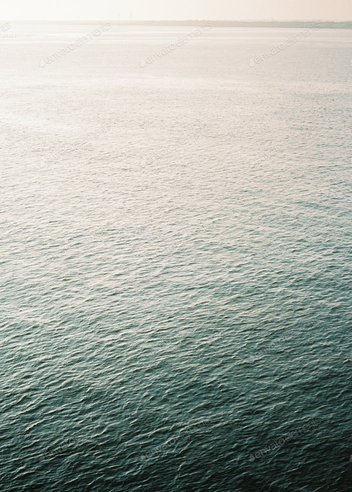 Portrait oriented photo of the ocean. Shot on film, full of detail, color and movement