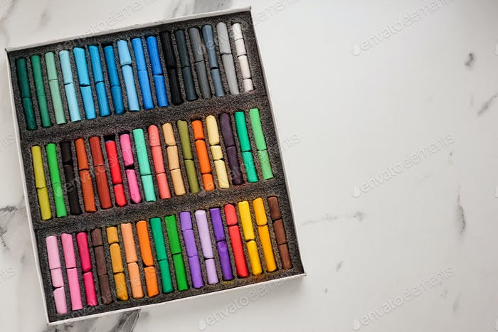 Multicolored artists soft pastels, chalks, crayons. Spectrum of colors. Background. N