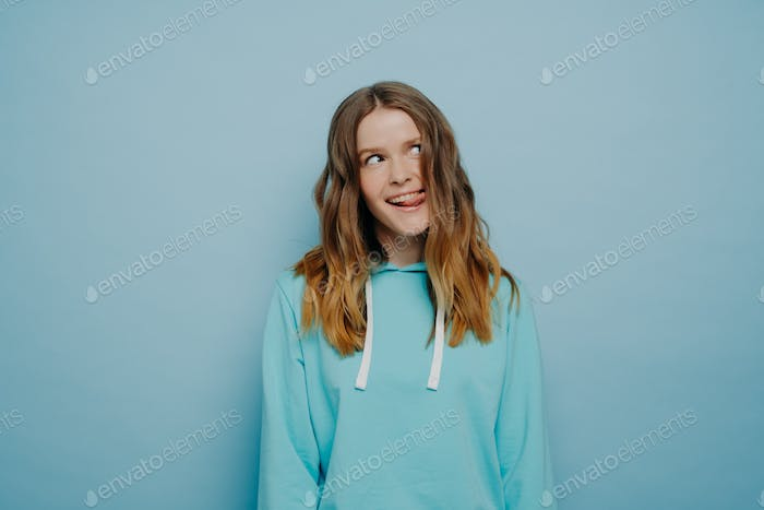 Young crazy pretty girl in light blue hoodie