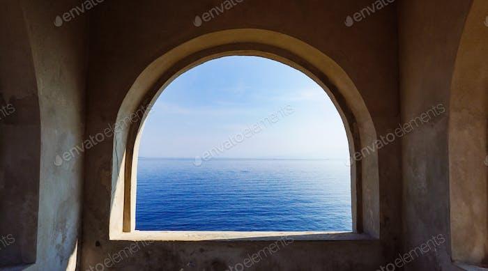 Minimalist concrete arc overlooking the ocean