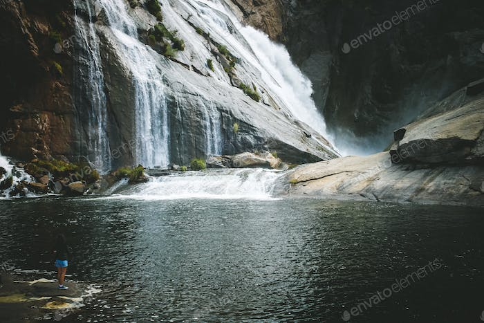 Tiny people in a waterfall