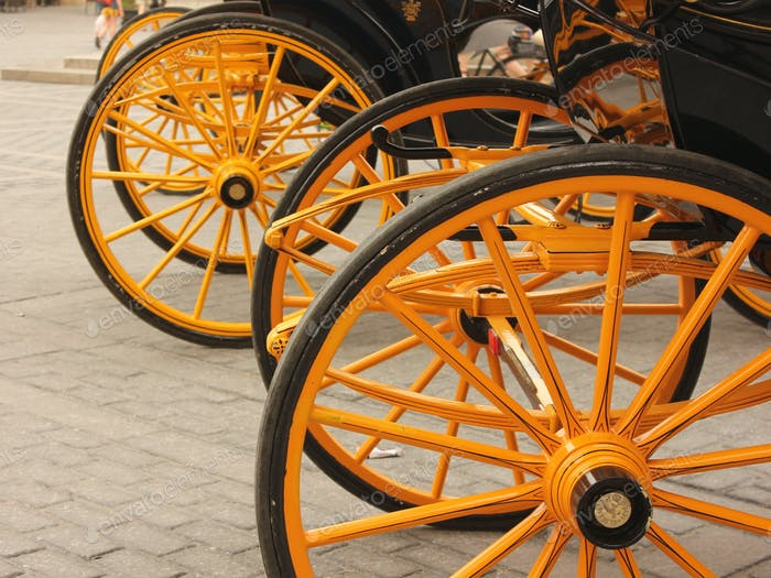 Yellow carriage wheels