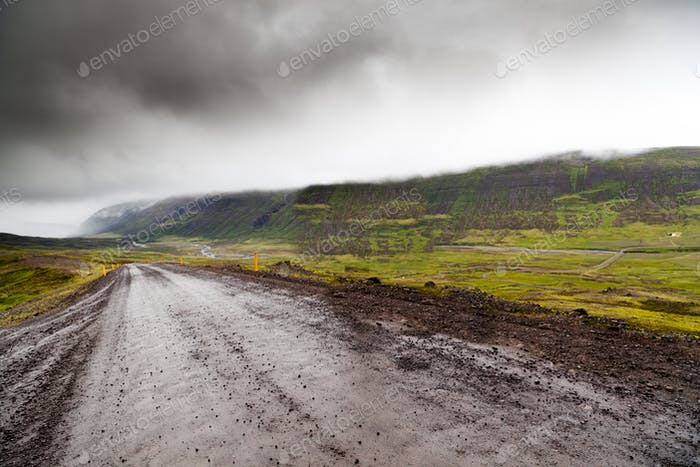 Empty gravel road in rural Iceland in the fog