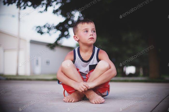 Thinking young boy thinking