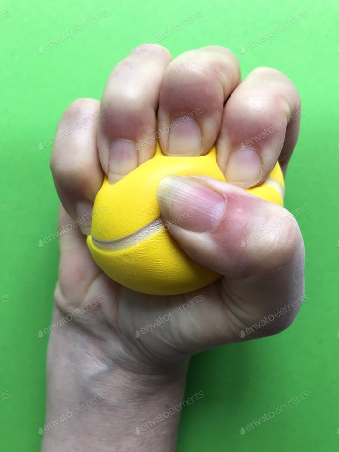 Stress Relief. : Stress ball in a clenched fist