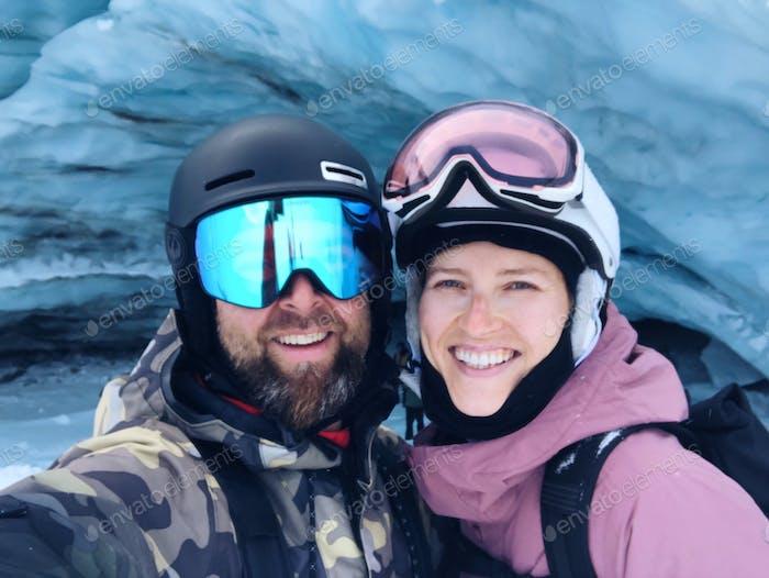 Happy couple wearing ski gear selfie