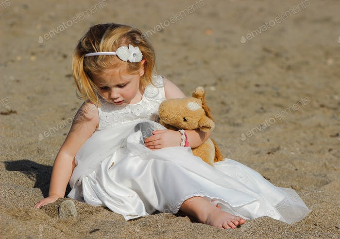 Young bridesmaid on the beach