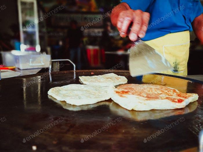Making of Roti Canai or Roti Prata famous Indian margarine flatbread in Malaysia.
