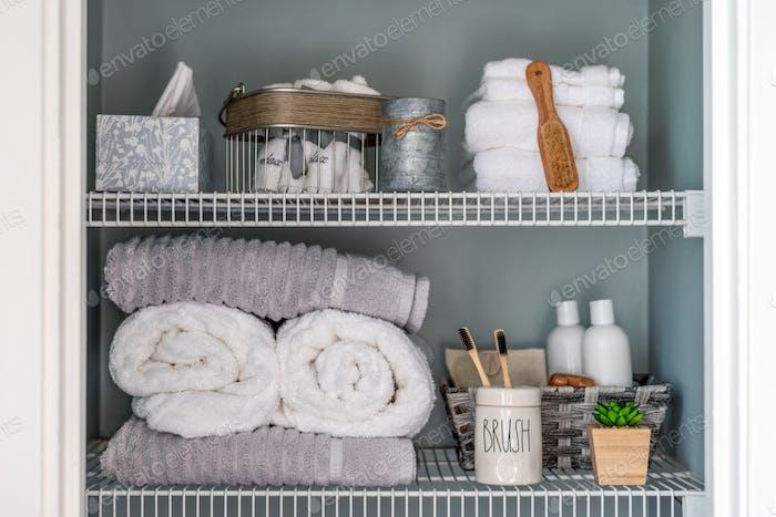 Neatly organized bathroom shelves