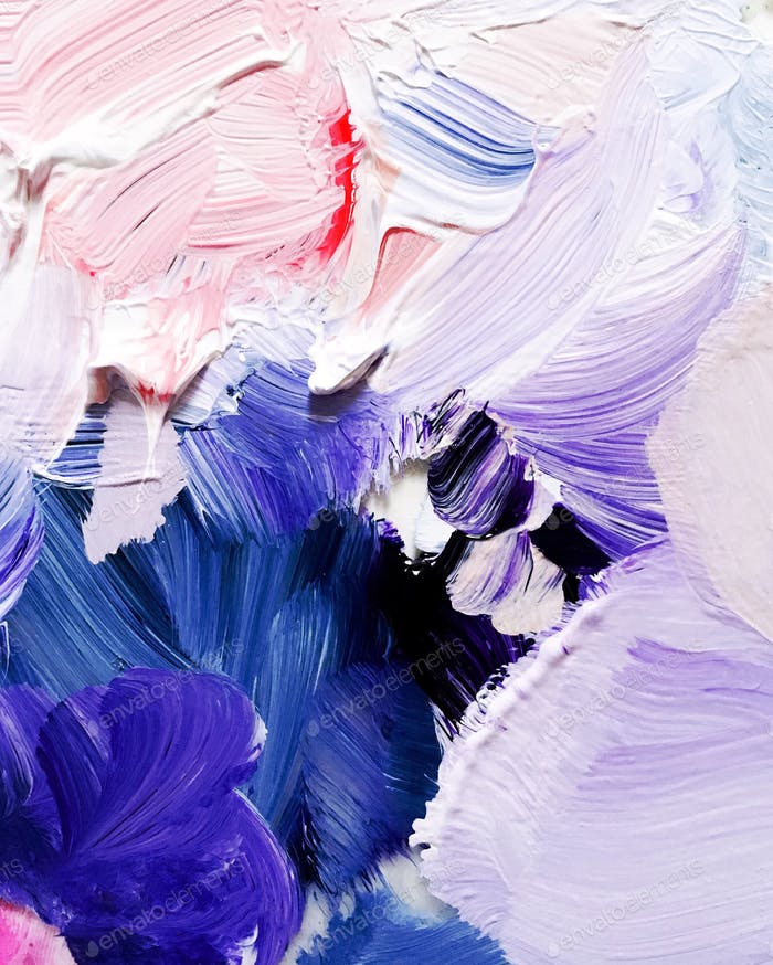 Full frame photo of blue and purple paint smeared on an artist's palette.