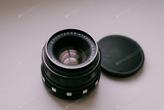 Pentacon lenses. Analog cameras. Retro. Analog photography. Simple white background.