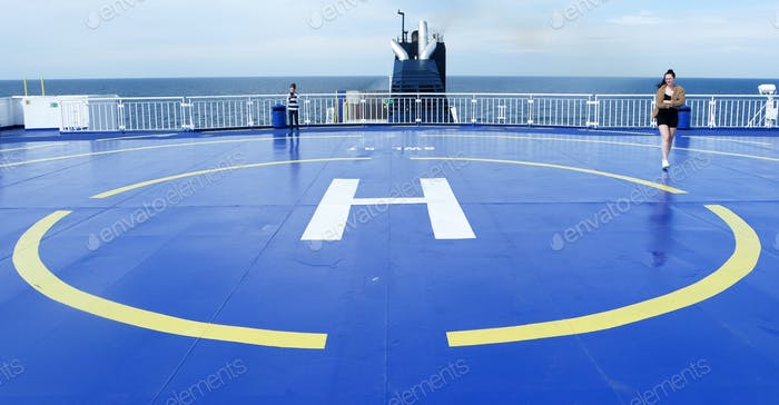 Helipad on the ferry with see view.