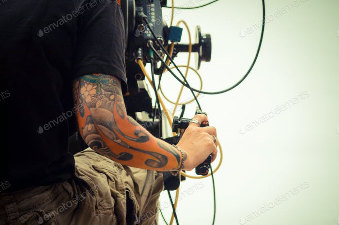 Tattoo'd camera operator on a movie set