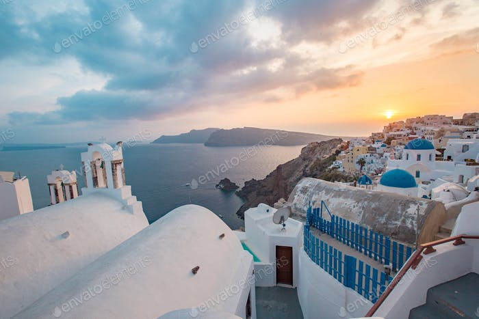 Sunset in santorini with buildings and the caldera in sight