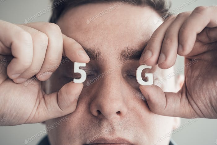 White letters 5G in closed eyes. Man faced to danger of harmful for health radiation of new wireless