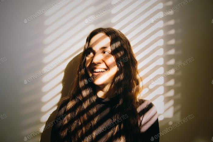 A happy young latina woman