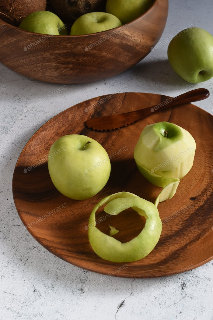 Apples on a wooden plate