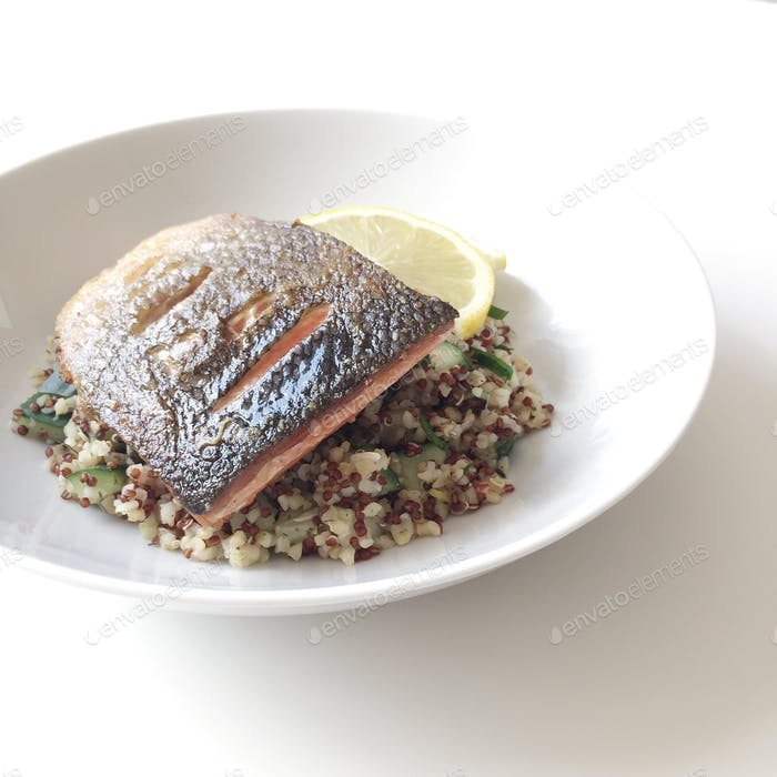 Another close-up shot of pan-seared salmon with warm bulgur and quinoa salad