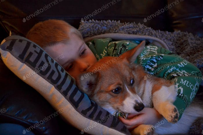 Boy and his dog watching television