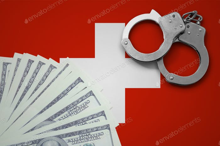 Switzerland flag  with handcuffs and a bundle of dollars