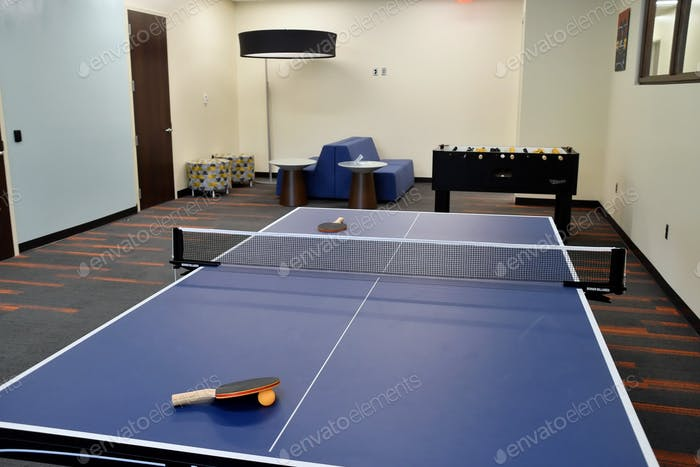 Clean, modern game room, break room, recreation area in an office building environment.
