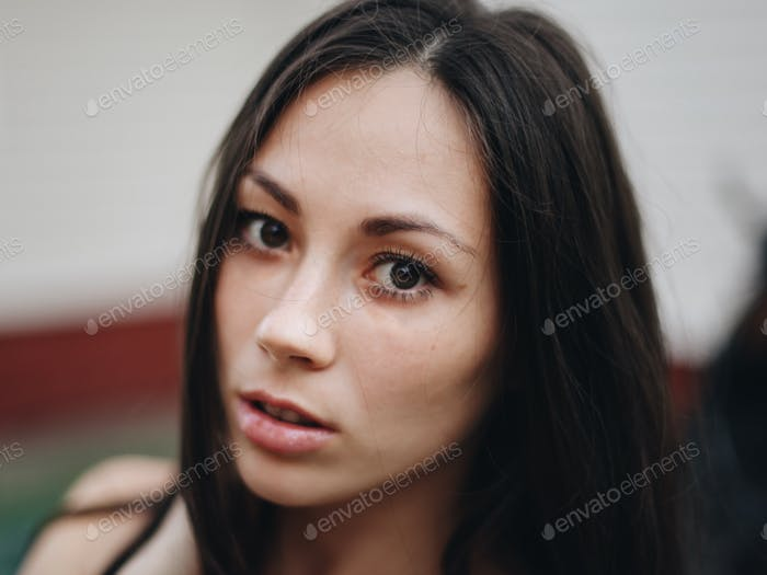 Macro portrait of black-haired woman