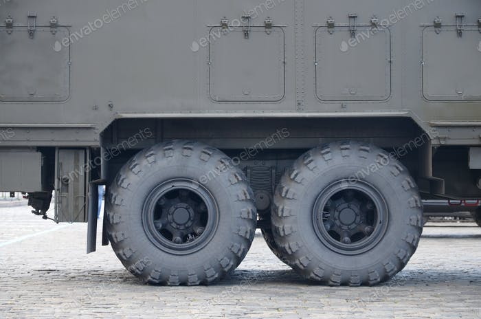 Close up view of green military truck. Modern military transportation vehicle technologies