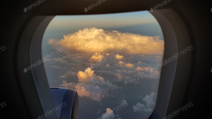View from the plane window to the sunset sky