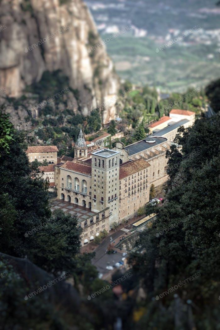 Santa Maria de Montserrat Monastery. View from the mountains. Tilt shift image.