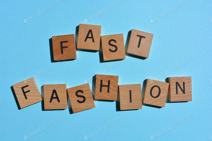 Fast Fashion, words in 3d wooden alphabet letters isolated on colourful background